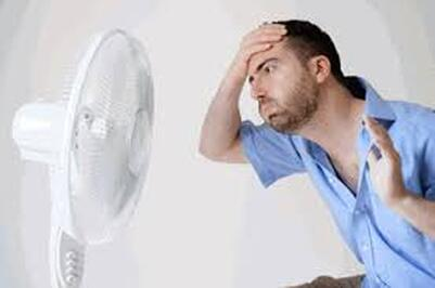 Man hot near fan