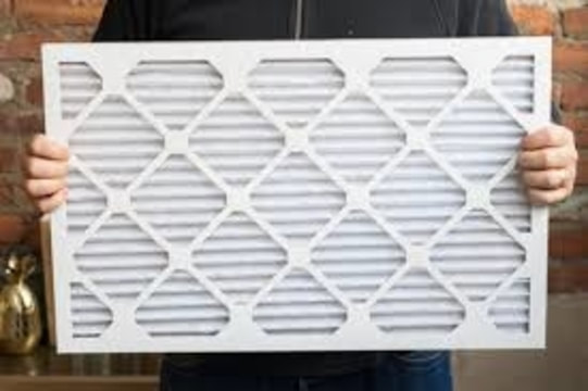 Man holding furnace filter